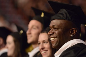 Graduate smiles during the Saint Rose commencement ceremony.