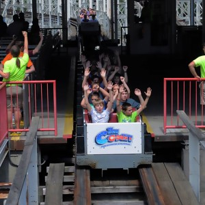 Students riding the Comet roller coaster