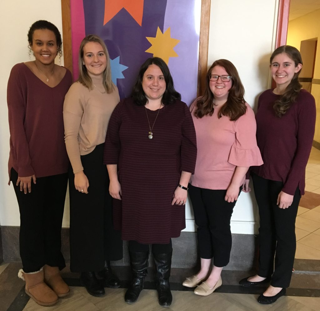 "Saint Rose Professor Katlyn Farnum standing with students who won the Psi Chi International Honor Society award with their project ""The Influence of Legal Knowledge on Retaliation."""