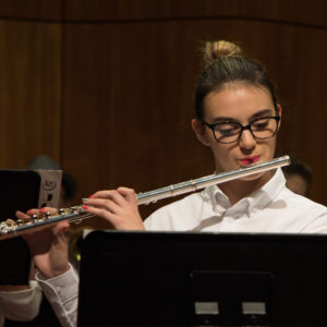 Girl playing the flute during the Pre-College Experience