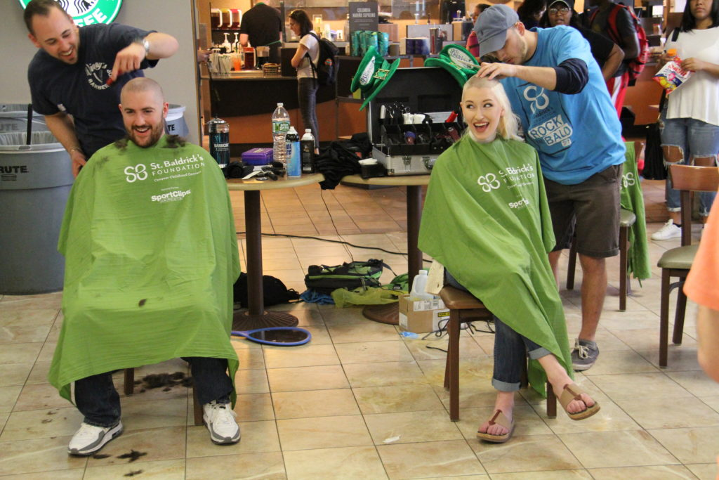 Students having their heads shaved on St. Baldrick's Day, a fundraiser at Saint Rose to combat childhood cancer.