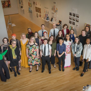 Group photo of 2018 Senior Show students and Gallery Director Jeanne Flannagan