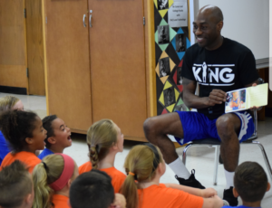 Tay Fisher teaching students in the classroom