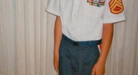 Josh Terry as a child dressed as a Marine